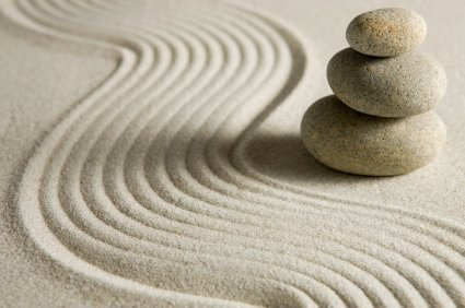 stacked stones on sand